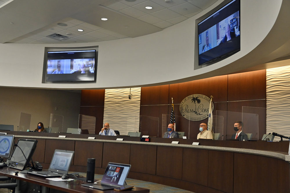 The council this morning, with one of its members and its attorney appearing by zoom, during the unremarkable appointment of a commission that will redistrict the city's voting districts in the next 120 days. (© FlaglerLive)