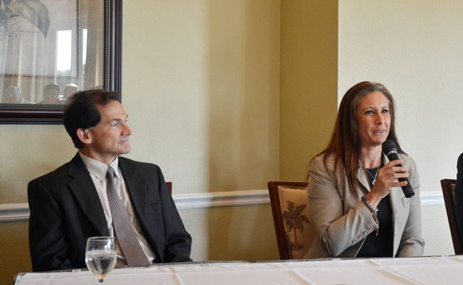 County Judge Melissa Moore-Stens at a Chamber of Commerce function last month, with Circuit Judge Dennis Craig. Moore-Stens held Phillip Haire Jr.'s first-appearance hearing, but Craig is handling the attempted murder case. Haire has yet to appear before Craig. (© FlaglerLive)