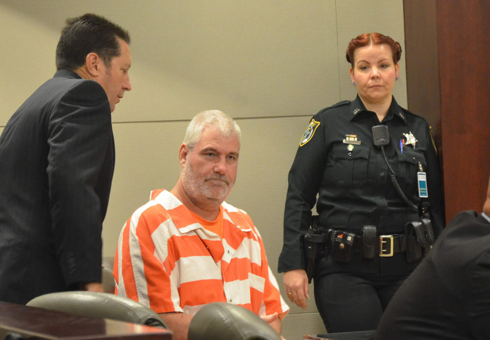 David Snelgrove, center, has been in jail and prison for the past 19 years. He is 46. He appeared in court today in Bunnell. One of his attorneys, Michael Nielsen, is to the left. (© FlaglerLive)