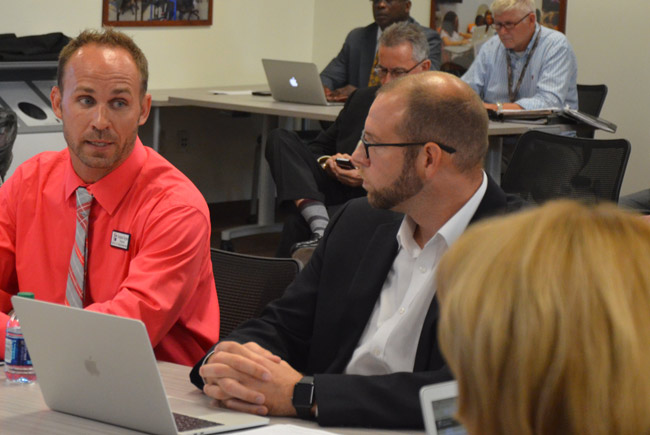 Ryan Deising, the Flagler school district's IT director, speaking to the school board this afternoon with Benjamin Osypian, principal at Old Kings Elementary, about various aspects of the district's technology initiatives. (© FlaglerLive)
