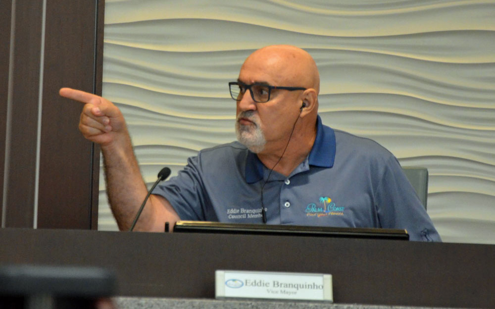 Palm Coast City Council member Eddie Branquinho as he addressed fellow-Councilman Victor Barbosa early this afternoon at a workshop. (© FlaglerLive)