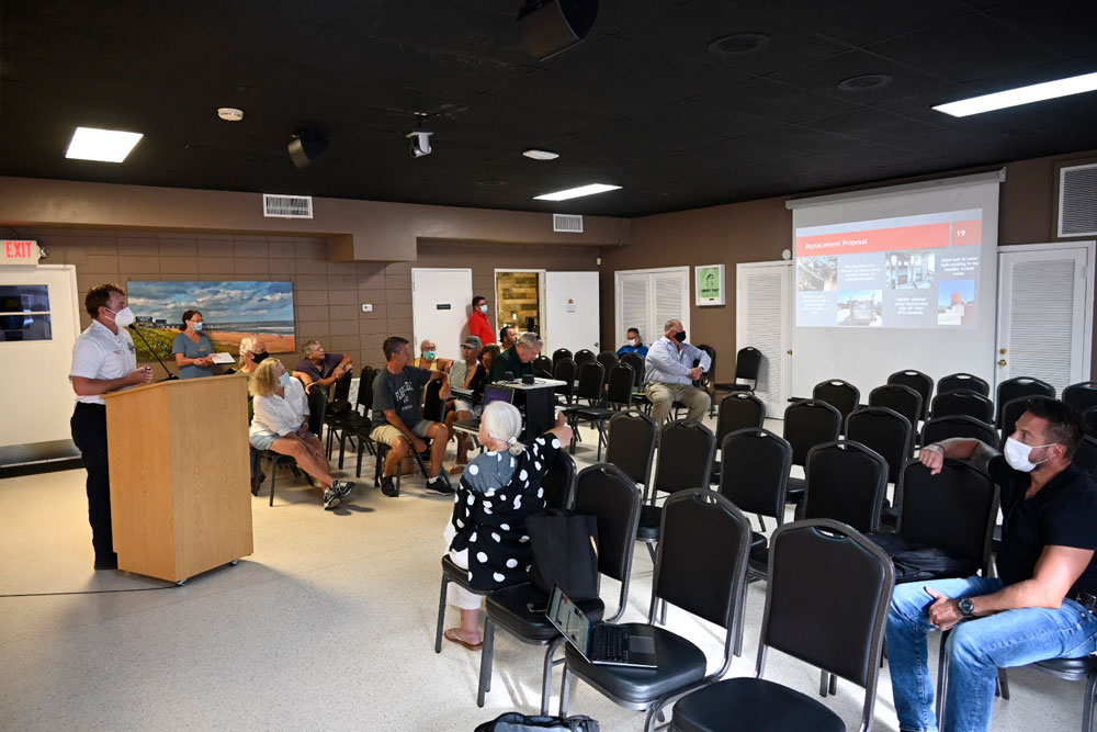 Flagler Beach Fire Captain Stephen Cox briefing the Flagler Beach City Commission and the public on the proposed purchase of a new fire truck at a special workshop Tuesday evening. (© FlaglerLive)