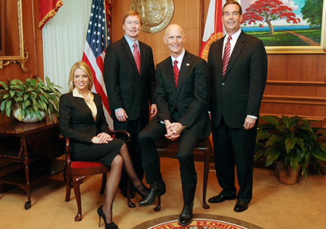 Don't believe their hype. The Florida Cabinet, from left: Pam Bondi, Adam Putnam, Rick Scott and Jeff Atwater.