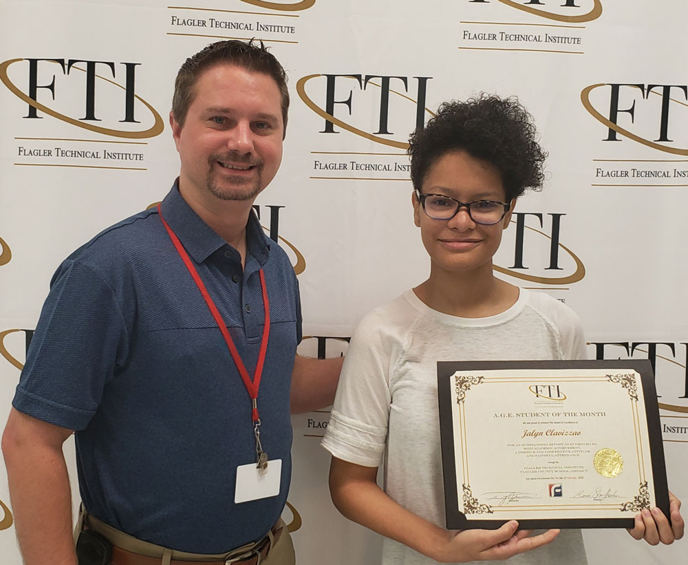 Program Facilitator Travis Thomas (left) with Jalyn Clavizzao (right) receiving her certificate