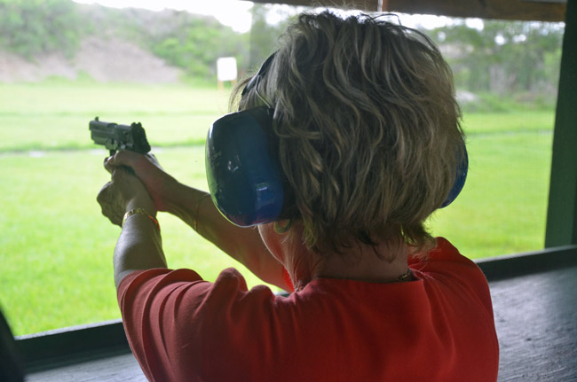 Flagler County Tax Collector Suzanne Johnston practicing shooting at the county's gun range last June, as part of her getting a concealed-carry permit. (© FlaglerLive)