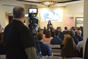 Palm Coast Mayor Milissa Holland, a director of development at Coastal Cloud, emceed the event and blurred her two roles, at one point urging her listeners to partner with the company. (© FlaglerLive)