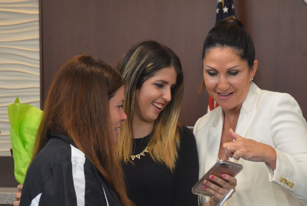 Palm Coast Mayor Milissa Holland at her swearing in in November 2016, with her daughter Tori, center, and Holland's sister, Jennifer Mellow. (© FlaglerLive)