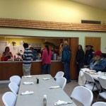 The homeless at a dinner organized at Bunnell's First United Methodist Church. (Sheltering Tree)