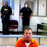 James Harris appearing by video link from the county jail in a bond hearing this afternoon. (© FlaglerLive)