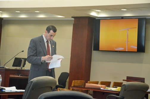 Assistant State Attorney Jason Lewis, going over his closing moments before the jury was brought back in  from a break. Click on the image for larger view. (© FlaglerLive)