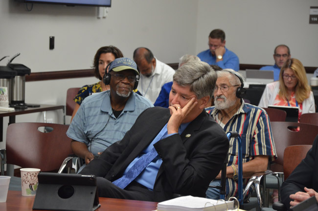Palm Coast City Manager Jim Landon in customary recline at this week's workshop with the council. (© FlaglerLive)