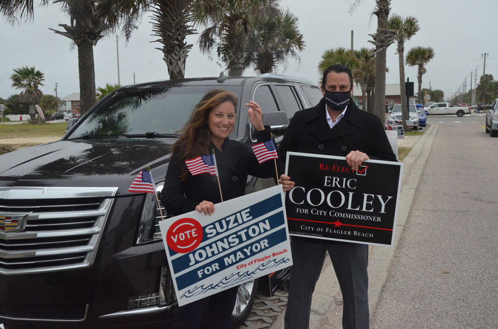 Suzie Johnston and Eric Cooley late this afternoon, a distance from the polling station at City Hall in Flagler Beach. (© FlaglerLive)