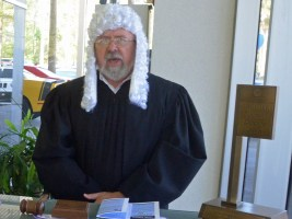 Closet barrister Robert Cuff, the Palm Coast City Council member, was the judge today, holding the bench at Palm Coast Ford. Click on the image for larger view. (© FlaglerLive)