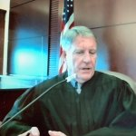 Circuit Judge Perkins in court today. He denied Flagler County government's motion to dismiss a lawsuit against it by Captain's BBQ, the restaurant at Bing's Landing. (© FlaglerLive)