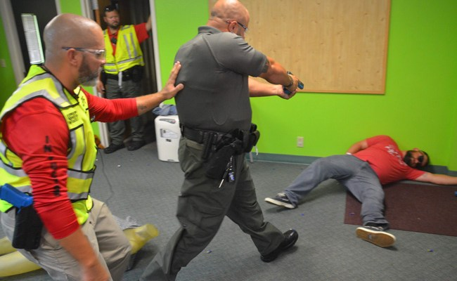 A Flagler County sheriff's deputy takes out a mass shooter during training today at Community Baptist Church in Korona. (© FlaglerLive)