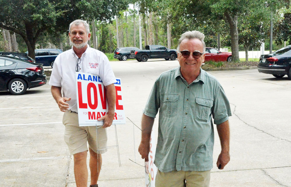 Ed Danko, the Palm Coast City Council member, in the foreground, has been campaigning on behalf of Alan Lowe, left, and advising or managing his campaign--a campaign using false and misleading accusations as a talking point. (© FlaglerLive)