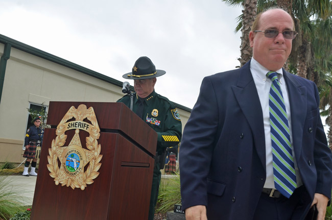Jim Manfre, in the foreground, walking away from Sheriff Rick Staly after receiving his retirement credentials at Staly's swearing-in, last January. (© FlaglerLive)
