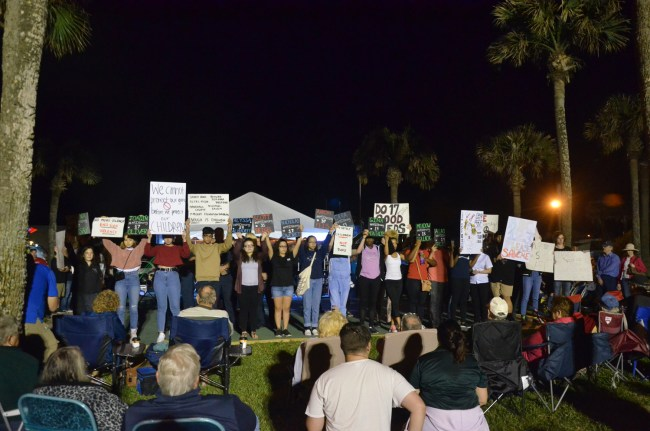 The students' march ended at Veterans Park during First Friday, where the names of the 17 victims of the Parkland massacre were read out loud as students held signs of the the names of those killed. Click on the image for larger view. (© FlaglerLive)