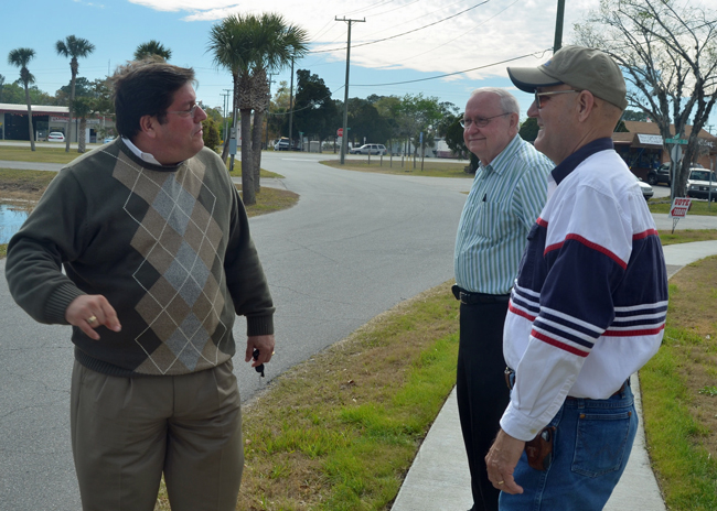 Armando Martinez, left, speaking with Elbert Tucker on Bunnell's Election Day in March 2013, when Tucker was re-elected and Bill Baxley, center, was elected, thus sealing Martinez's fate. (© FlaglerLive)