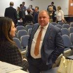 Palm Coast City Manager Matt Morton in a conversation with Mayor Milissa Holland last November. (© FlaglerLive)