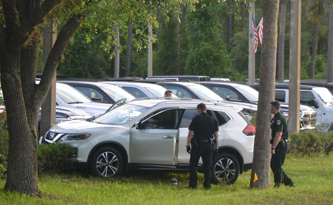 George J. Serafino's Nissan did not suffer significant damage after it veered off State Road 100 in Palm Coast and crashed into a concrete pole. (© FlaglerLive)