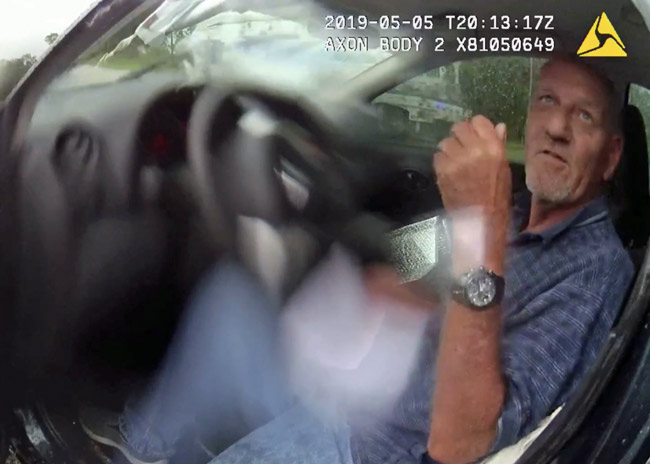 Brenton M. Hodge after the crash, from a deputy's body cam.