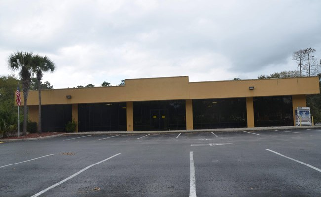 The Sears building on Palm Coast Parkway. The county was planning to turn it over to the sheriff. (© FlaglerLive)