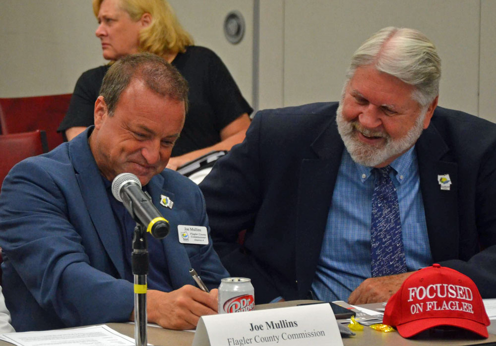 County Commissioner Joe Mullins, left, and County Administrator Jerry Cameron made a land deal focused on St. Johns County. (© FlaglerLive)
