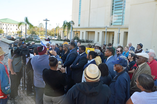 What was billed as a 'news conference' by the NAACP regarding the case of two students' racist threats toward a black teacher, held this afternoon in front of the county courthouse, trended more toward grandstanding statements and allegations rather than revelations, with the exception of brief statements by the threatened teacher herself. (c FlaglerLive)