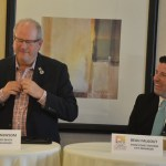 Flagler Beach City Manager Larry Newsom, standing, and Palm Coast Interim Manager Beau Falgout frequently stole the show with their humor at this morning's Common Ground breakfast organized by the Flagler Chamber of Commerce at the Palm Coast Hilton. (© FlaglerLive)