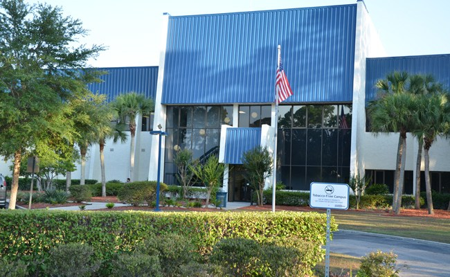 Palm Coast Data acquired the old City Hall building for $3 million in 2008, when the company thought it would be expanding significantly over subsequent years. It has only shrunk, and it may have to lease back one of its three buildings before long, its CEO says. (© FlaglerLive)