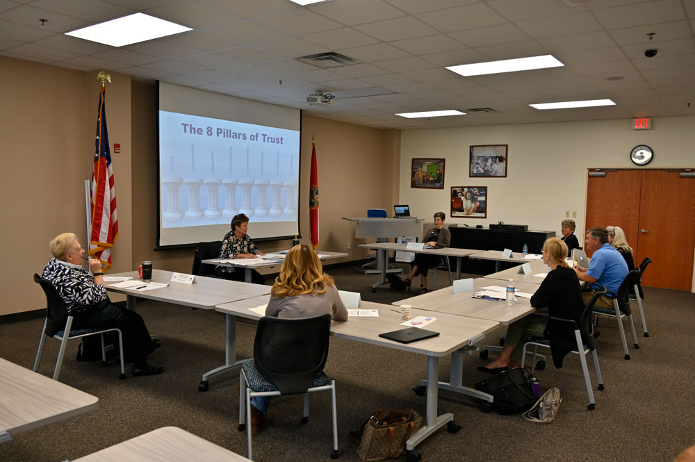 The Flagler County School Board at its 'retreat' on Sept. 9: it has a long way to go to scale the eight pillars of trust. (© FlaglerLive)