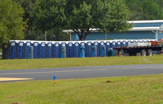 Portable toilets set up at the county airport in preparation for an expected (or wished for) onslaught of Florida Power and Light personnel and contracted linemen, who are staging at the airport. (© FlaglerLive)