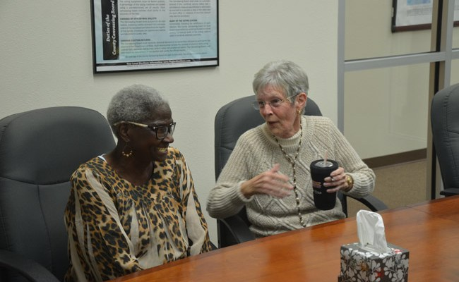 The Kleenex was not necessary: Daisy Henry, left, accepted defeat graciously at a canvassing board meeting this afternoon when a recount proved unnecessary in the race won by Jan Reeger for a special election to the Bunnell City Commission. (© FlaglerLive)
