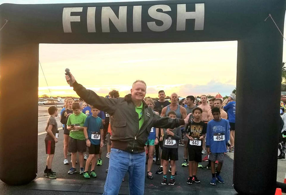 Roy Sieger, the county airport director and a member of Flagler Beach Rotary, at last year's Race to the Runway event. (Facebook)