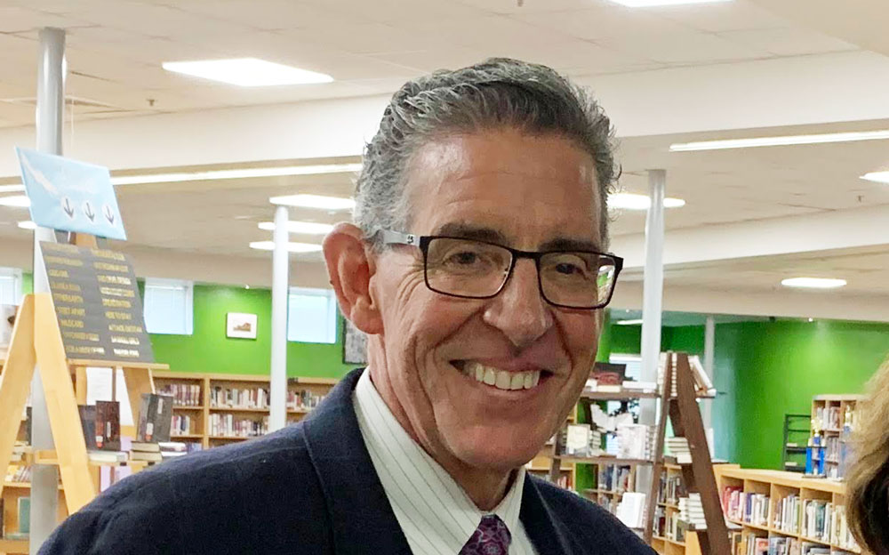 Tom Russell last summer at the FPC library, when he hosted a meet-and-greet ahead of his tenure as principal. (© FlaglerLive)
