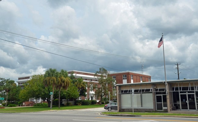 The proposed location of Flagler County's Safe Haven, adjacent to the Bunnell branch library, is across the street from the old courthouse. (© FlaglerLive)