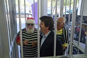 Rick Giumenta, the prison stripes covering his famed Santa garb, with his attorney, Michael Chiumento III, who was jailed without a warrant. Click on the image for larger view. (© FlaglerLive)