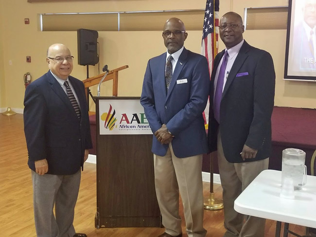 From left, Wilfredo Gonzales, district director of the Small Business Administration, Leslie Giscombe, the African American Entrepreneurs Association's leader, and Thaddeus Hammond, a business opportunity specialist with the SBA. (AAEA)