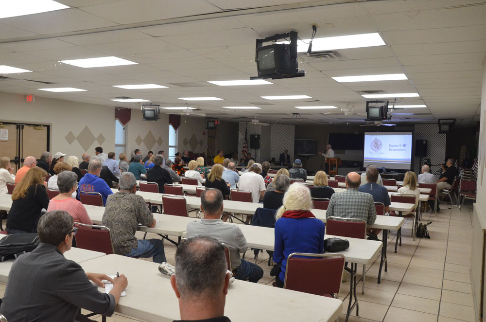 Scores of beachside property owners and Flagler Beach residents turned out for a meeting on the planned beach renourishment of 2.6 miles of beach starting later this year. The meeting was hosted by county officials and held at Santa Maria del Mar Catholic Church in Flagler Beach. (© FlaglerLive)