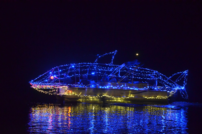 A boat decorated as a shark during last Saturday's  Holiday Boat Parade in Palm Coast. (c FlaglerLive)