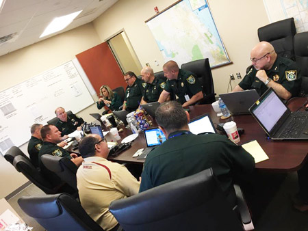 Flagler County Sheriff Rick Staly, at the head of the table, with his command staff at this morning';s briefing. (Facebook)