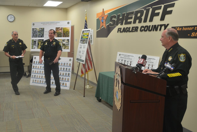 Sheriff Rick Staly, right, preparing to address the press today with Sheriff Mike Chitwood and Sheriff Gator Deloach. (© FlaglerLive)