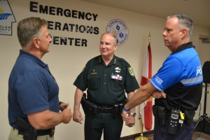 Sheriff Rick Staly, center, with Flagler Beach Police Chief Matthew Doughney, right, and Bunnell Police Chief Tom Foster during the Hurricane Irma emergency two years ago. (© FlaglerLive)