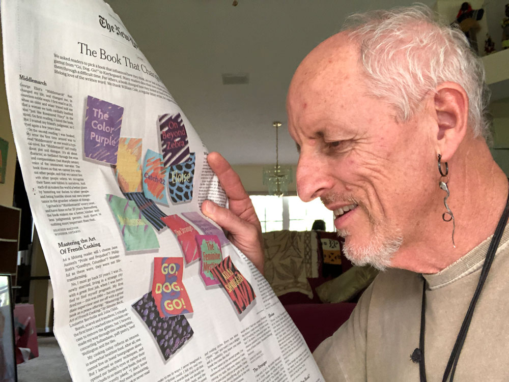 Rick de Yampert with a copy of The New York Times opened to the Sunday Review page with his mini-essay on the book that changed his life. (© FlaglerLive)