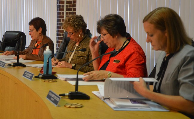 The Flagler Beach City Commission's Jane Mealy (left), Kim Carney (third from left)_ and Mayor Linda Provencher, foreground, attended a closed-door county staff meeting with the U.S. Corps of Engineers last week, raising questions of sunshine violations. Joy McGrew, second from left, was not involved. (© FlaglerLive)