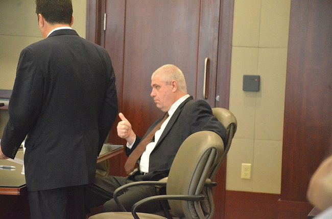 Just after the jury went into deliberations, Judge Kathryn Weston asked David Snelgrove if he'd been satisfied with his representation. He gave the thumbs up. (© FlaglerLive)