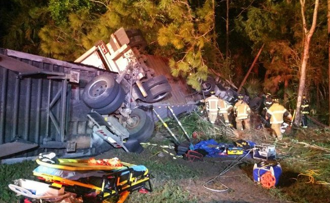 The UPS truck rolled over off I-95. (Flagler County)