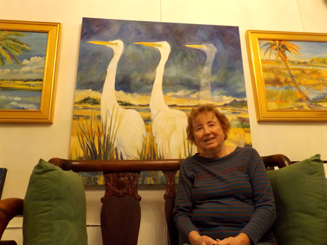 Flagler Artist of the Year Trish Vevera with her painting, 'And Then There Were Two.' (c FlaglerLive)