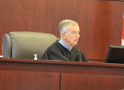 Senior Judge J. David Walsh sat in for Dennis Craig at today's hearing. (© FlaglerLive)